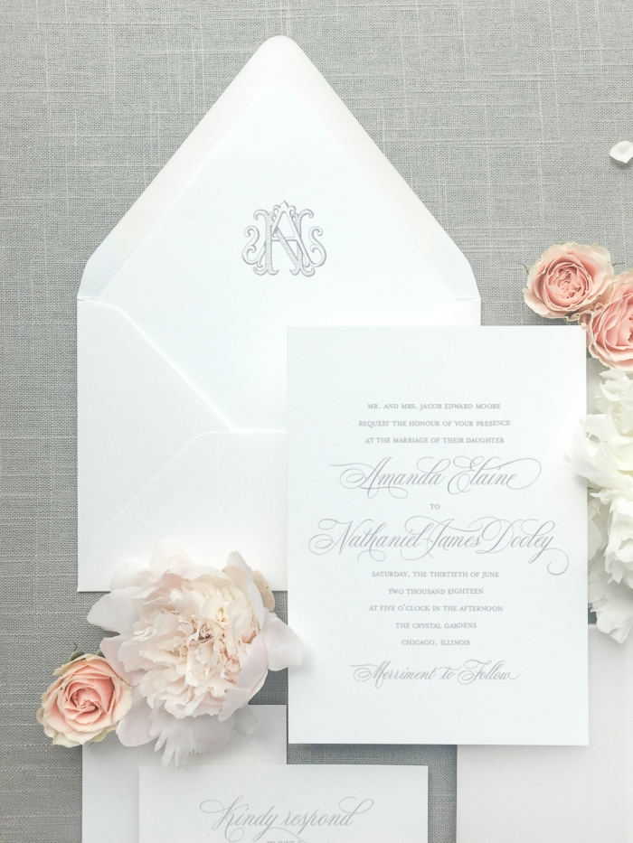 This invitation suite features an envelope liner with a hand drawn vintage monogram which is an upgrade in the wedding collection. The wedding collection is made up of a traditional layout and artful elements to tailor your wedding invitation to your style. Available in digital printing, letterpress, and foil stamping. Custom wedding invitations by Little Fox Paperie.