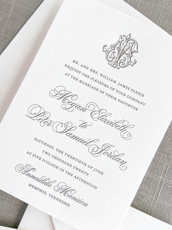 Wedding invitation printed in letterpress with slate ink on ivory paper. Includes a vintage interlocking monogram.