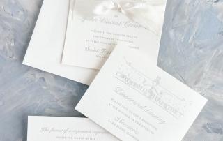 Cloud light blue letterpress wedding invitations with custom monogram printed in blind letterpress. Custom letterpress venue illustration reception card. Letterpress response RSVP card. Ivory paper. White silk ribbon tied around invitation.