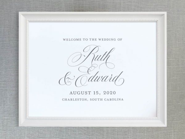 Wedding welcome sign with traditional script names.